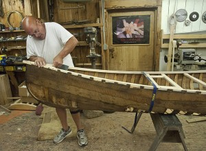 Bob Welcome restores his old canoe at Thomson's.
