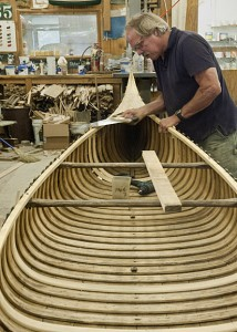 Thomson at work on a nearly finished new canoe.