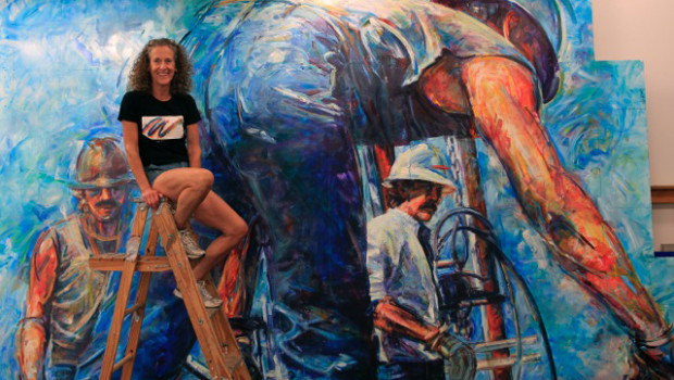 Ellen griesdieck with a portion of the american mural for American mural project
